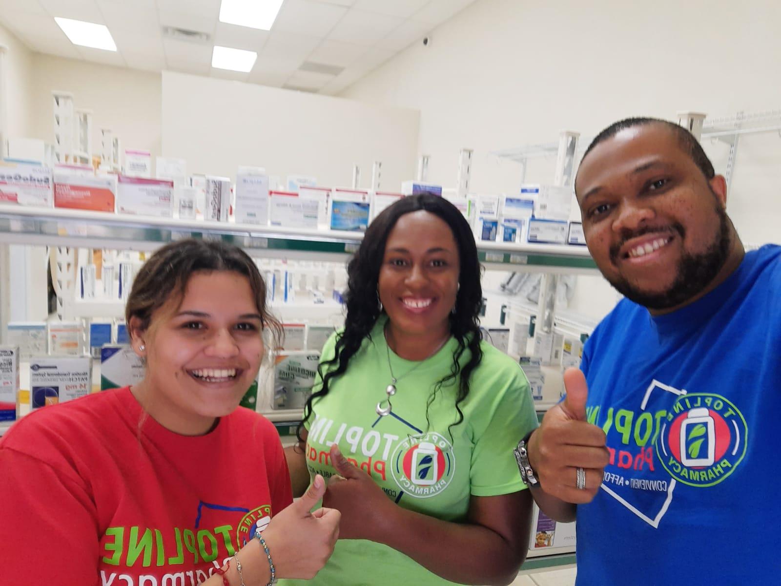Topline Pharmacy staff-laughing Staff